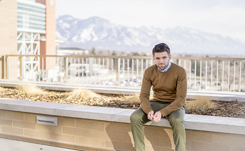 S. Wyatt Young, a Christian author, novelist, and Bible teacher, sits contemplatively on the University of Utah's campus.
