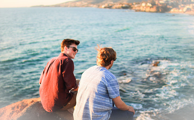 Two friends sit on a rock overlooking the ocean shore. Paul writes that ours is a ministry of reconciliation, but what is the practice of reconciliation, and why is it so important to the Christian life?