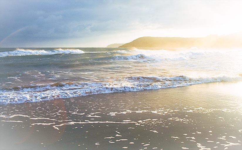 """The sun rises over a beach amidst storm clouds. In this post, S. Wyatt Young answers the question, """"What is a covenant?"""" and explains how our understanding of covenant shapes the way we relate to God and elucidates his faithfulness."""
