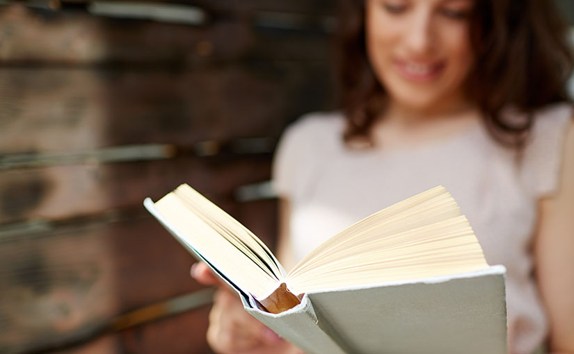 A young woman is captivated by a story she's reading. In this open letter to millennials, S. Wyatt Young encourages millennials to pick up the old book their parents threw out and become a part of a bigger story.